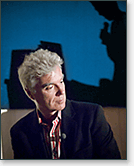 David Byrne listens to Ken Goldberg during GBU slides